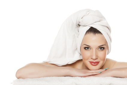 portrait of a beautiful young woman with a towel on her head